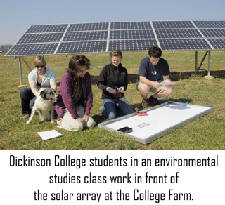 Students in an environmental-studies class work in front of the solar array at the College Farm.