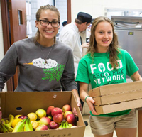 Lycoming students Julian and Johanna with food donations